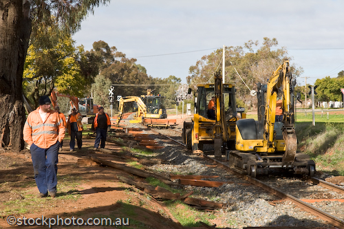 activities;activity;equipment;gender;gumtree;hill;human;human being;human beings;humans;line;machinery;male;man;masculine;men;people;person;rail;red;repair;sleepers;swan;tracks;vic;work;workers;working