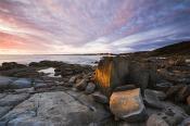 environment;scenery;sky;sunset;land;rocks;water;ocean;seascape;sea;horizontal;we