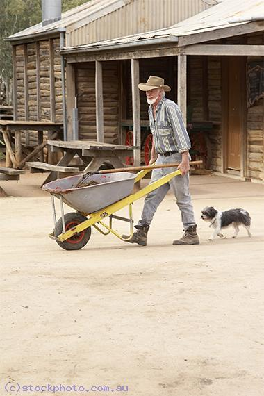 pioneer;settlement;swan;hill;victoria;old;old;fashioned;architecture;building;animals;pets;dog;doggie;love;one;another;man;wheelbarrow;vertical;