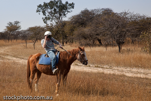 RIDE;RIDER;africa;animal;antelope;beautiful;bush;camers;cloud;country;environment;equine;farm;field;friends;grass;gweru;holiday;hoof;horizontal;horse;horsemen;horseriding;journey;landscape;lens;male;man;mane;nature;outback;outdoors;park;photograph;picture;saddle;scenery;slr;tourism;travel;treks;vacation;view;wild;zimbabwe