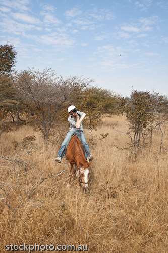 RIDE;RIDER;africa;animal;antelope;beautiful;bush;camers;cloud;country;environment;equine;farm;field;friends;grass;gweru;holiday;hoof;horizontal;horse;horsemen;horseriding;journey;landscape;lens;male;man;mane;nature;outback;outdoors;park;photograph;picture;saddle;scenery;slr;tourism;travel;treks;vacation;vertical;view;walk;wild;zimbabwe